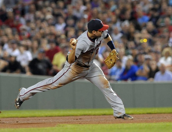 Jun 16, 2014; Boston, MA, USA; Minnesota Twins second baseman Brian Dozier (2) throws to first base during the sixth inning against the Boston Red Sox at Fenway Park. Mandatory Credit: Bob DeChiara-USA TODAY Sports