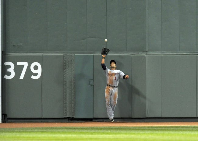 Jun 16, 2014; Boston, MA, USA; Minnesota Twins center fielder Sam Fuld (1) makes a catch on the warning track on a ball hit by Boston Red Sox designated hitter David Ortiz (not pictured) during the sixth inning at Fenway Park. Mandatory Credit: Bob DeChiara-USA TODAY Sports
