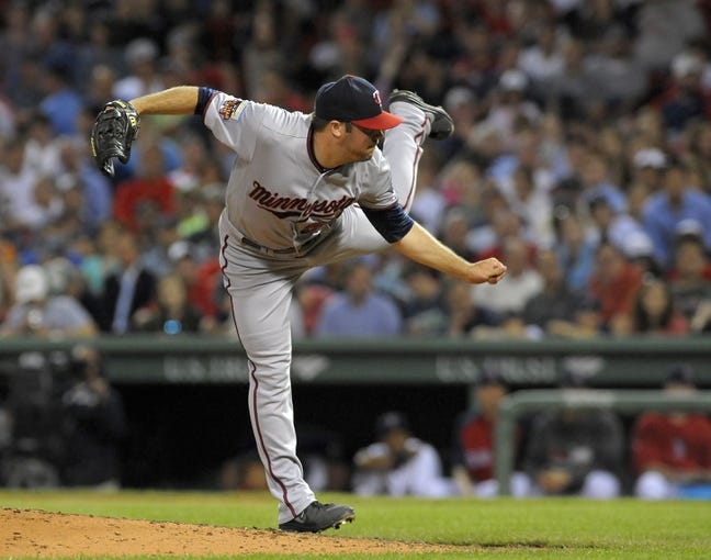 Jun 16, 2014; Boston, MA, USA; Minnesota Twins relief pitcher Caleb Thielbar (56) pitches during the seventh inning against the Boston Red Sox at Fenway Park. Mandatory Credit: Bob DeChiara-USA TODAY Sports