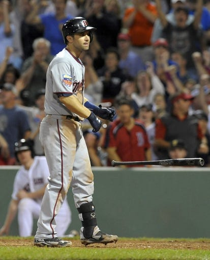 Jun 16, 2014; Boston, MA, USA; Minnesota Twins second baseman Brian Dozier (2) reacts after striking out with the bases loaded during the eight inning against the Boston Red Sox at Fenway Park. Mandatory Credit: Bob DeChiara-USA TODAY Sports