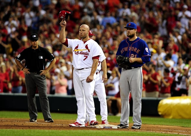 Jun 16, 2014; St. Louis, MO, USA; St. Louis Cardinals left fielder Matt Holliday (7) salutes the fans after driving in his 1,000 career RBI during the fifth inning against the New York Mets at Busch Stadium. Mandatory Credit: Jeff Curry-USA TODAY Sports