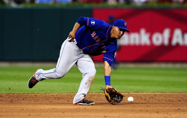 Jun 16, 2014; St. Louis, MO, USA; New York Mets shortstop Ruben Tejada (11) fields a ground ball hit by St. Louis Cardinals shortstop Jhonny Peralta (not pictured) during the fourth inning at Busch Stadium. Mandatory Credit: Jeff Curry-USA TODAY Sports