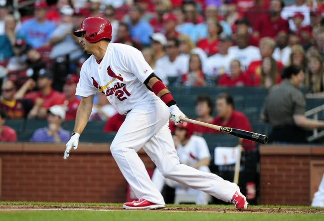 Jun 16, 2014; St. Louis, MO, USA; St. Louis Cardinals right fielder Allen Craig (21) hits a one run single off of New York Mets starting pitcher Jacob deGrom (not pictured) during the first inning at Busch Stadium. The Cardinals defeated the Mets 6-2. Mandatory Credit: Jeff Curry-USA TODAY Sports