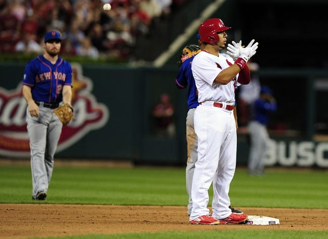 Jun 16, 2014; St. Louis, MO, USA; St. Louis Cardinals center fielder Jon Jay (19) celrbates a double during the fifth inning against the New York Mets at Busch Stadium. The Cardinals defeated the Mets 6-2. Mandatory Credit: Jeff Curry-USA TODAY Sports