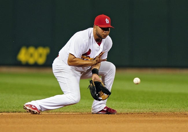 Jun 16, 2014; St. Louis, MO, USA; St. Louis Cardinals shortstop Jhonny Peralta (27) fields a ground ball hit by New York Mets pinch hitter Eric Campbell (not pictured) during the seventh inning at Busch Stadium. The Cardinals defeated the Mets 6-2. Mandatory Credit: Jeff Curry-USA TODAY Sports