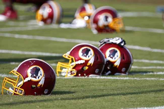 Jun 17, 2014; Ashburn, VA, USA; Washington Redskins helmets rest on the field during minicamp at Redskins Park. Mandatory Credit: Geoff Burke-USA TODAY Sports