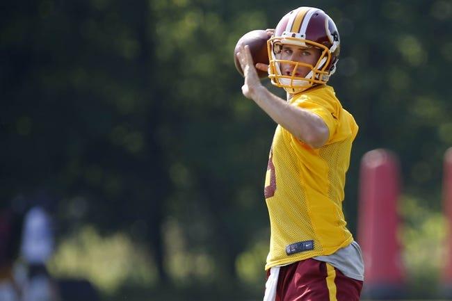 Jun 17, 2014; Ashburn, VA, USA; Washington Redskins quarterback Kirk Cousins (8) throws the ball during minicamp at Redskins Park. Mandatory Credit: Geoff Burke-USA TODAY Sports