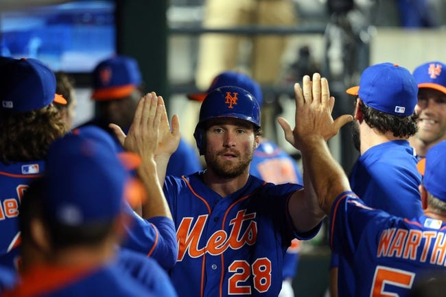Jun 13, 2014; New York, NY, USA; New York Mets second baseman Daniel Murphy (28) is congratulated after scoring against the San Diego Padres during the fifth inning of a game at Citi Field. The Mets defeated the Padres 6-2. Mandatory Credit: Brad Penner-USA TODAY Sports