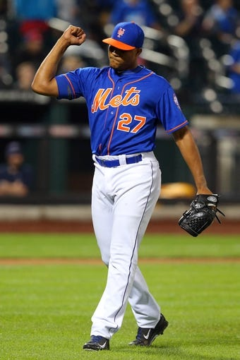 Jun 13, 2014; New York, NY, USA; New York Mets relief pitcher Jeurys Familia (27) reacts after defeating the San Diego Padres in a game at Citi Field. The Mets defeated the Padres 6-2. Mandatory Credit: Brad Penner-USA TODAY Sports