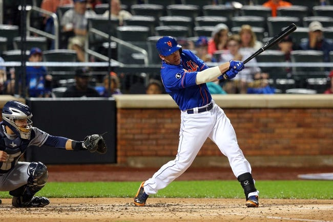 Jun 13, 2014; New York, NY, USA; New York Mets catcher Taylor Teagarden (23) hits an RBI single against the San Diego Padres during the second inning of a game at Citi Field. The Mets defeated the Padres 6-2. Mandatory Credit: Brad Penner-USA TODAY Sports