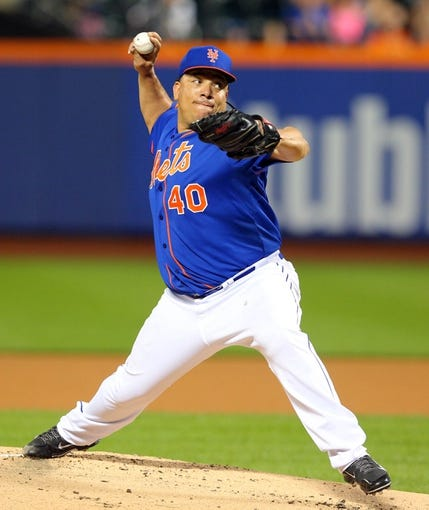 Jun 13, 2014; New York, NY, USA; New York Mets starting pitcher Bartolo Colon (40) pitches against the San Diego Padres during the first inning of a game at Citi Field. Mandatory Credit: Brad Penner-USA TODAY Sports