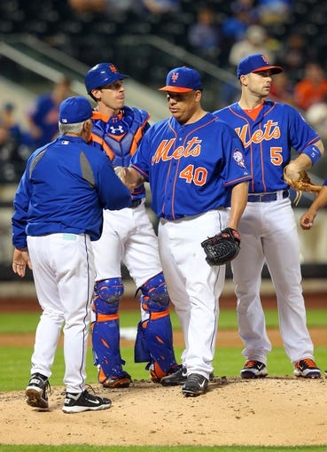 Jun 13, 2014; New York, NY, USA; New York Mets starting pitcher Bartolo Colon (40) is taken out of the game by New York Mets manager Terry Collins (10) during the eighth inning of a game against the San Diego Padres at Citi Field. The Mets defeated the Padres 6-2. Mandatory Credit: Brad Penner-USA TODAY Sports