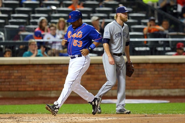 Jun 13, 2014; New York, NY, USA; New York Mets right fielder Bobby Abreu (53) scores a run in front of San Diego Padres starting pitcher Andrew Cashner (34) during the second inning of a game at Citi Field. The Mets defeated the Padres 6-2. Mandatory Credit: Brad Penner-USA TODAY Sports