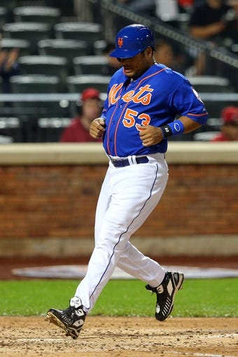 Jun 13, 2014; New York, NY, USA; New York Mets right fielder Bobby Abreu (53) scores a run against the San Diego Padres during the fourth inning of a game at Citi Field. The Mets defeated the Padres 6-2. Mandatory Credit: Brad Penner-USA TODAY Sports