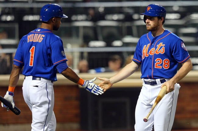 Jun 13, 2014; New York, NY, USA; New York Mets second baseman Daniel Murphy (28) is congratulated by New York Mets left fielder Chris Young (1) after scoring a run against the San Diego Padres during the seventh inning of a game at Citi Field. The Mets defeated the Padres 6-2. Mandatory Credit: Brad Penner-USA TODAY Sports