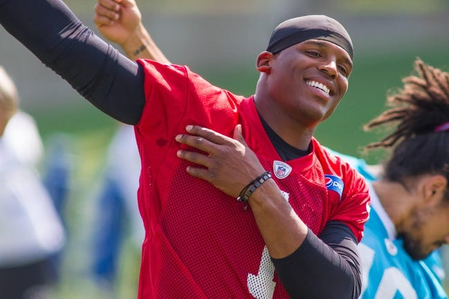 Jun 17, 2014; Charlotte, NC, USA; Carolina Panthers quarterback Cam Newton stretches during the minicamp held at the Carolina Panthers practice facility. Mandatory Credit: Jeremy Brevard-USA TODAY Sports