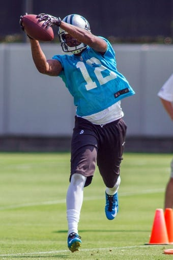 Jun 17, 2014; Charlotte, NC, USA; Carolina Panthers wide receiver Tavarres King catches a pass during the minicamp held at the Carolina Panthers practice facility. Mandatory Credit: Jeremy Brevard-USA TODAY Sports