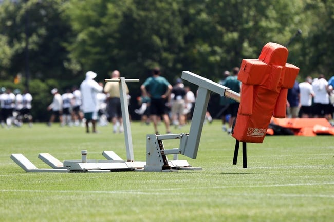 Jun 17, 2014; Philadelphia, PA, USA; A tackle sled with general practice play behind it during mini camp at the Philadelphia Eagles NovaCare Complex. Mandatory Credit: Bill Streicher-USA TODAY Sports