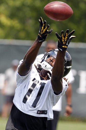 Jun 17, 2014; Pittsburgh, PA, USA; Pittsburgh Steelers receiver Markus Wheaton (11) participates in drills during minicamp at the UPMC Sports Performance Complex. Mandatory Credit: Charles LeClaire-USA TODAY Sports