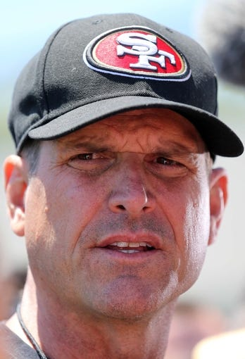 Jun 17, 2014; San Francisco, CA, USA; San Francisco 49ers head coach Jim Harbaugh speaks to the media during minicamp at the 49ers practice facility. Mandatory Credit: Kelley L Cox-USA TODAY Sports