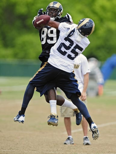 Jun 17, 2014; St. Louis, MO, USA; St. Louis Rams tight end Jared Cook (89) and St. Louis Rams safety T.J. McDonald (25) battle for the ball during minicamp at Rams Park. Mandatory Credit: Jeff Curry-USA TODAY Sports