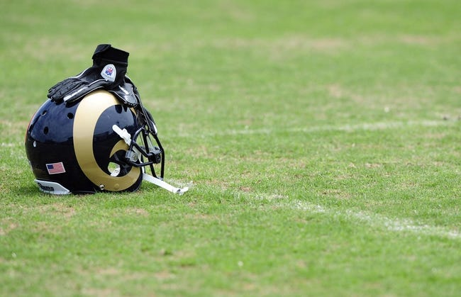 Jun 17, 2014; St. Louis, MO, USA; St. Louis Rams helmet sits on the grass during minicamp at Rams Park. Mandatory Credit: Jeff Curry-USA TODAY Sports