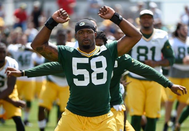 Jun 17, 2014; Green Bay, WI, USA; Green Bay Packers linebacker Sam Barrington stretches during the team's minicamp at Ray Nitschke Field. Mandatory Credit: Benny Sieu-USA TODAY Sports