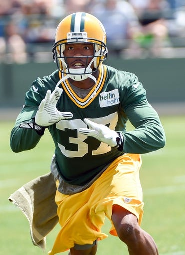Jun 17, 2014; Green Bay, WI, USA;  Green Bay Packers cornerback Sam Shields practices during the team's minicamp at Ray Nitschke Field. Mandatory Credit: Benny Sieu-USA TODAY Sports