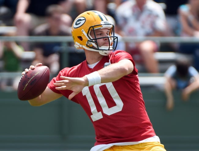 Jun 17, 2014; Green Bay, WI, USA;  Green Bay Packers quarterback Matt Flynn practices during the team's minicamp at Ray Nitschke Field. Mandatory Credit: Benny Sieu-USA TODAY Sports