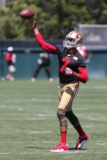 Jun 17, 2014; Santa Clara, CA, USA; San Francisco 49ers quarterback Colin Kaepernick (7) throws the ball during minicamp at the 49ers practice facility. Mandatory Credit: Kelley L Cox-USA TODAY Sports