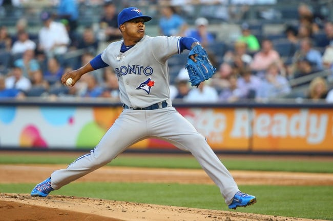 Jun 17, 2014; Bronx, NY, USA; Toronto Blue Jays starting pitcher Marcus Stroman (54) pitches during the first inning against the New York Yankees at Yankee Stadium. Mandatory Credit: Anthony Gruppuso-USA TODAY Sports