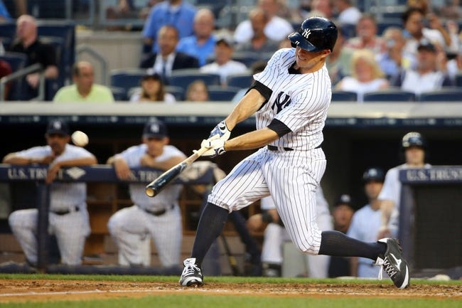 Jun 17, 2014; Bronx, NY, USA;  New York Yankees left fielder Brett Gardner (11) hits a home run to right bringing in first baseman Kelly Johnson (not pictured) to score during the third inning against the Toronto Blue Jays at Yankee Stadium. Mandatory Credit: Anthony Gruppuso-USA TODAY Sports