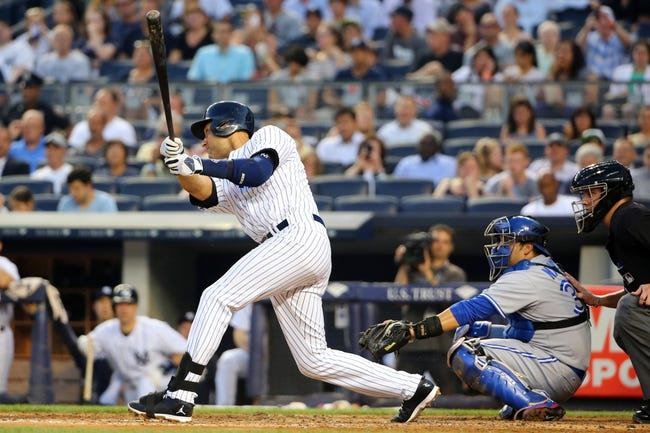 Jun 17, 2014; Bronx, NY, USA;  New York Yankees shortstop Derek Jeter (2) singles to right during the third inning against the Toronto Blue Jays at Yankee Stadium. Mandatory Credit: Anthony Gruppuso-USA TODAY Sports