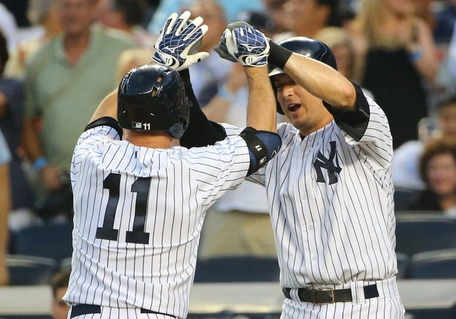 Jun 17, 2014; Bronx, NY, USA;  New York Yankees left fielder Brett Gardner (11) and first baseman Kelly Johnson (33) celebrate scoring during the third inning against the Toronto Blue Jays at Yankee Stadium. Mandatory Credit: Anthony Gruppuso-USA TODAY Sports