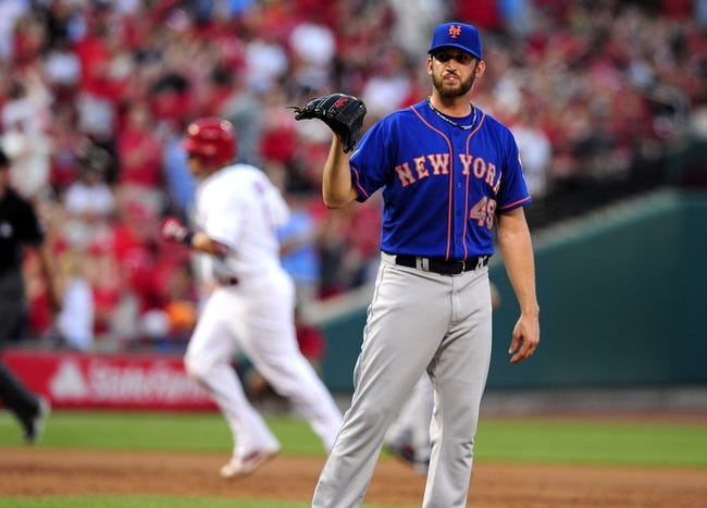 Jun 17, 2014; St. Louis, MO, USA; New York Mets starting pitcher Jonathon Niese (49) waits for a new ball after giving up a solo home run to St. Louis Cardinals catcher Yadier Molina (4) during the second inning at Busch Stadium. Mandatory Credit: Jeff Curry-USA TODAY Sports