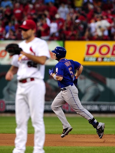 Jun 17, 2014; St. Louis, MO, USA; New York Mets third baseman David Wright (5) runs the bases after hitting a solo home run off of St. Louis Cardinals starting pitcher Michael Wacha (52) during the fourth inning at Busch Stadium. Mandatory Credit: Jeff Curry-USA TODAY Sports