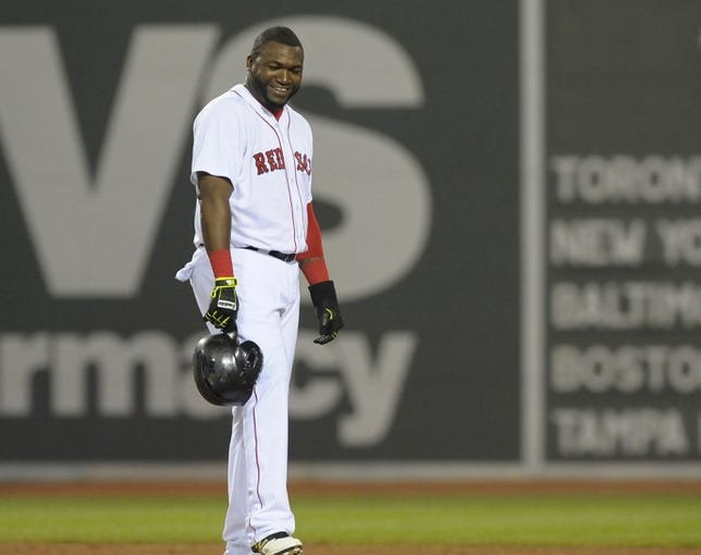 Jun 17, 2014; Boston, MA, USA; Boston Red Sox designated hitter David Ortiz (34) stands on second base after a single by second baseman Dustin Pedroia (not pictured) during the sixth inning at Fenway Park. Mandatory Credit: Bob DeChiara-USA TODAY Sports