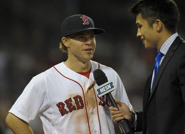Jun 17, 2014; Boston, MA, USA; Boston Red Sox right fielder Brock Holt (26) is interviewed by NESN reporter Gary Striewski  after defeating the Minnesota Twins at Fenway Park. Mandatory Credit: Bob DeChiara-USA TODAY Sports