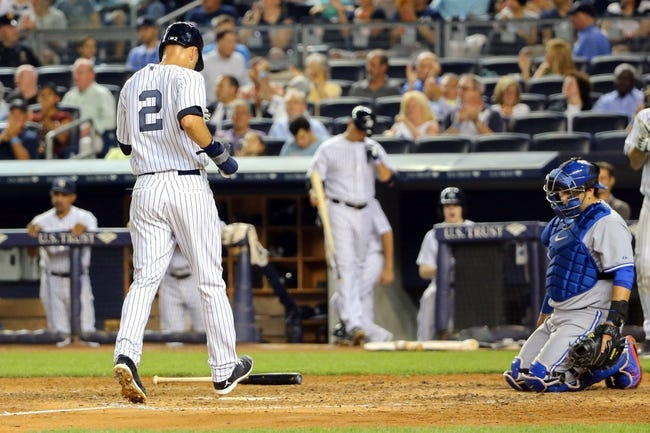 Jun 17, 2014; Bronx, NY, USA;  New York Yankees shortstop Derek Jeter (2) crosses the plate to score during the fifth inning against the Toronto Blue Jays at Yankee Stadium. New York Yankees won 3-1. Mandatory Credit: Anthony Gruppuso-USA TODAY Sports