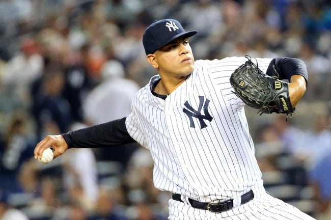 Jun 17, 2014; Bronx, NY, USA;  New York Yankees relief pitcher Dellin Betances (68) delivers a pitch during the seventh inning against the Toronto Blue Jays at Yankee Stadium. New York Yankees won 3-1. Mandatory Credit: Anthony Gruppuso-USA TODAY Sports