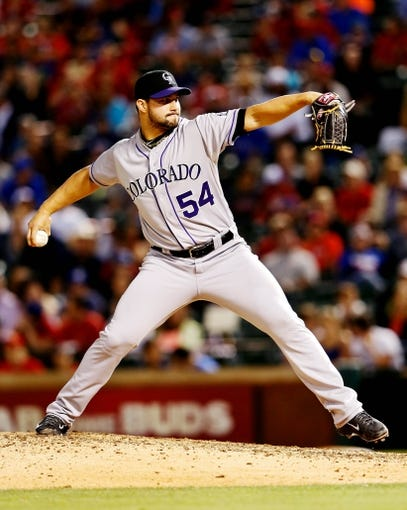 May 8, 2014; Arlington, TX, USA; Colorado Rockies relief pitcher Tommy Kahnle (54) throws during the game against the Texas Rangers at Globe Life Park in Arlington. Texas won 5-0. Mandatory Credit: Kevin Jairaj-USA TODAY Sports
