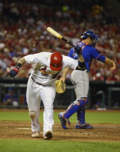 Jun 17, 2014; St. Louis, MO, USA; St. Louis Cardinals catcher Yadier Molina (4) reacts aster striking out during the seventh inning against the New York Mets at Busch Stadium. The Cardinals defeated the Mets 5-2. Mandatory Credit: Jeff Curry-USA TODAY Sports