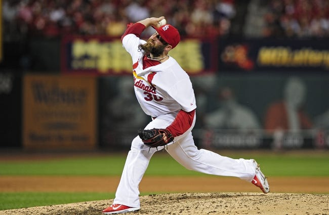 Jun 17, 2014; St. Louis, MO, USA; St. Louis Cardinals relief pitcher Jason Motte (30) throws to a New York Mets batter during the ninth inning at Busch Stadium. The Cardinals defeated the Mets 5-2. Mandatory Credit: Jeff Curry-USA TODAY Sports