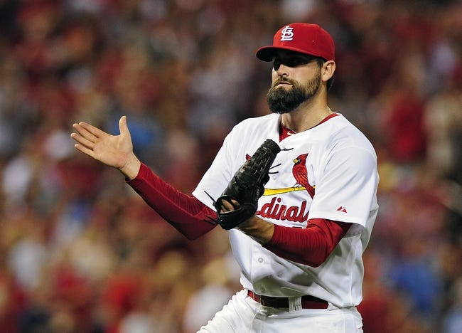 Jun 17, 2014; St. Louis, MO, USA; St. Louis Cardinals relief pitcher Pat Neshek (41) celebrates after getting the final out of the ninth inning against the New York Mets at Busch Stadium. The Cardinals defeated the Mets 5-2. Mandatory Credit: Jeff Curry-USA TODAY Sports