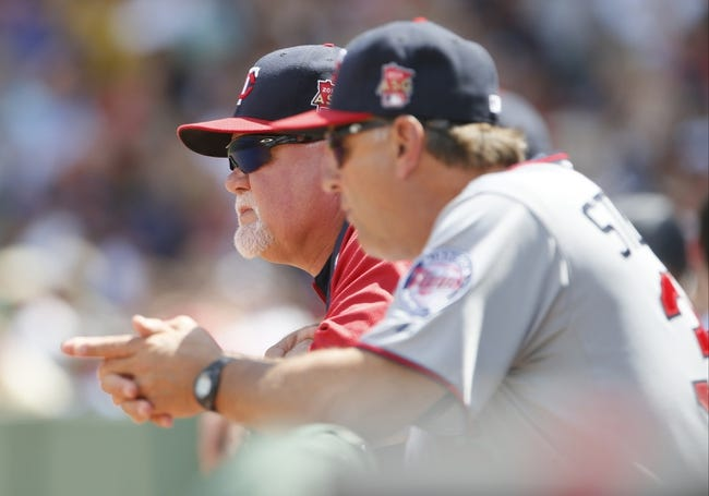 Jun 18, 2014; Boston, MA, USA; Minnesota Twins manager Ron Gardenhire (left) and bench/catching coach Terry Steinbach (36) look on as they take on the Boston Red Sox in the fourth inning at Fenway Park. Mandatory Credit: David Butler II-USA TODAY Sports