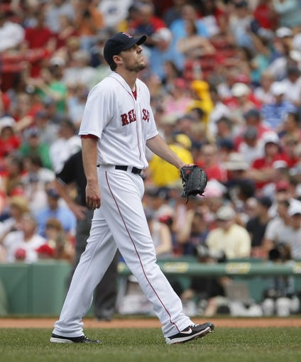 Jun 18, 2014; Boston, MA, USA; Boston Red Sox starting pitcher John Lackey (41) gives up a hit by Minnesota Twins right fielder Chris Parmelee (not pictured) in the fifth inning at Fenway Park. Mandatory Credit: David Butler II-USA TODAY Sports