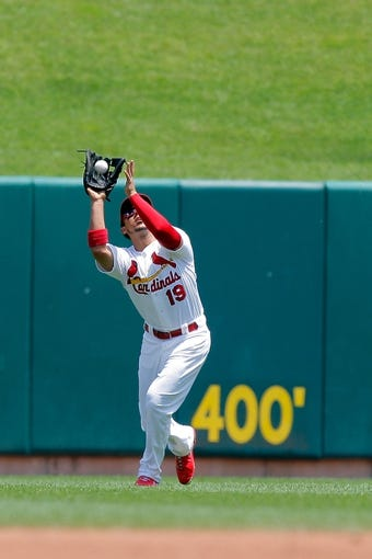 Jun 18, 2014; St. Louis, MO, USA; St. Louis Cardinals center fielder Jon Jay (19) catches for an out against New York Mets first baseman Lucas Duda (21, not pictured) during the second inning at Busch Stadium. Mandatory Credit: Scott Kane-USA TODAY Sports