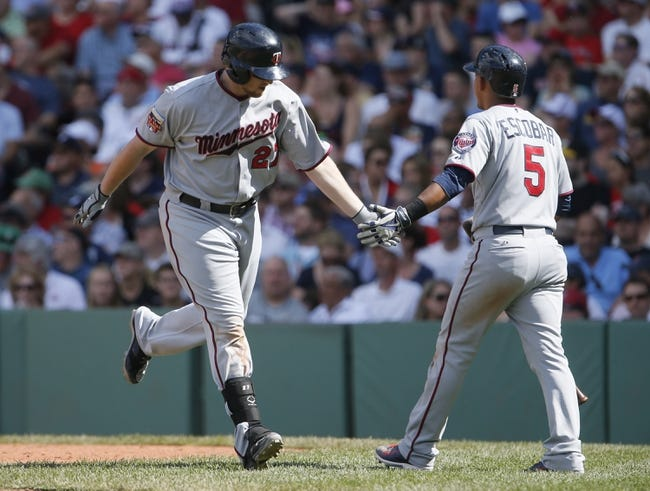 Jun 18, 2014; Boston, MA, USA; Minnesota Twins right fielder Chris Parmelee (27) is congratulated by shortstop Eduardo Escobar (5) after hitting a home run against the Boston Red Sox in the tenth inning at Fenway Park. Mandatory Credit: David Butler II-USA TODAY Sports