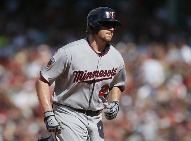 Jun 18, 2014; Boston, MA, USA; Minnesota Twins right fielder Chris Parmelee (27) runs the bases after hitting a home run against the Boston Red Sox in the tenth inning at Fenway Park. Mandatory Credit: David Butler II-USA TODAY Sports