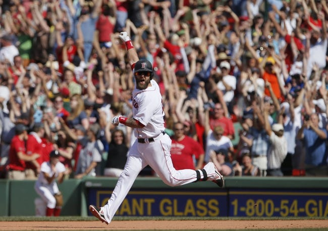 Jun 18, 2014; Boston, MA, USA; Boston Red Sox first baseman Mike Napoli (12) reacts after hitting the game winning home run against the Minnesota Twins in the tenth inning at Fenway Park. The Red Sox defeated the Twins 2-1. Mandatory Credit: David Butler II-USA TODAY Sports